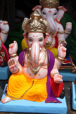 idol: A closeup of Lord Ganesha Idol for sale on the eve of Ganesh festival in India. Stock Photo
