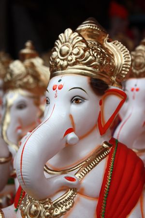 idol: A closeup portrait of the face of Lord Ganesha Idol for sale on the eve of Ganesh festival in India. Stock Photo