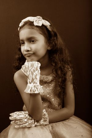 A classic fairytale like picture of a pouting sad Indian princess in sepia tone. photo