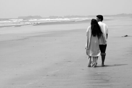 A metaphorical image of an Indian couple on a holiday daydreaming about their future on a beach. photo
