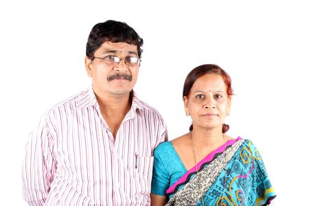 A portrait of a East Indian middle-aged couple, isolated on a white background.