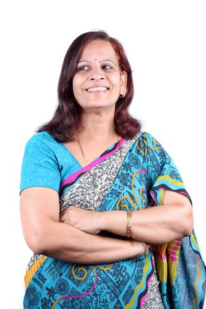 A portrait of a traditional middle-aged Indian woman in a sari, on white studio background. photo