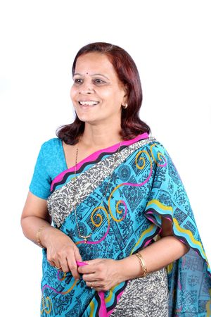 A portrait of a middle-aged Indian woman in a traditional sari, on white studio background. Stock Photo