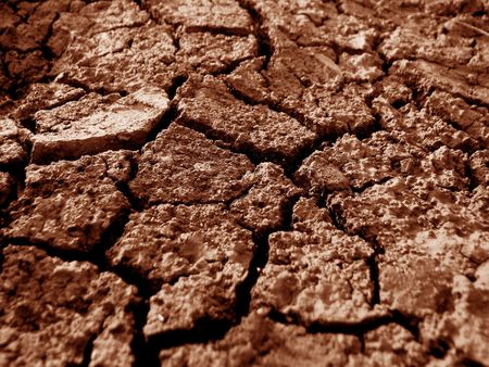 famine: A background of dry red earth during famine.