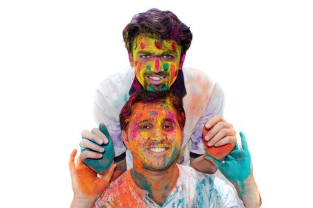 A portrait of two Indian friends with their faces traditionally covered, during HOLI festival photo