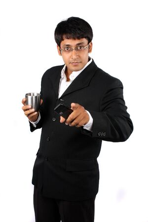 A confident Indian businessman pointing at the camera, on white studio background. photo
