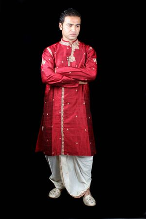 kurta: A royal Indian man in a worried mood, isolated on black studio background.