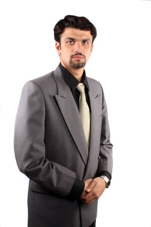 A portrait of a handsome young Indian businessman, isolated on white studio background. Stock Photo - 6723999