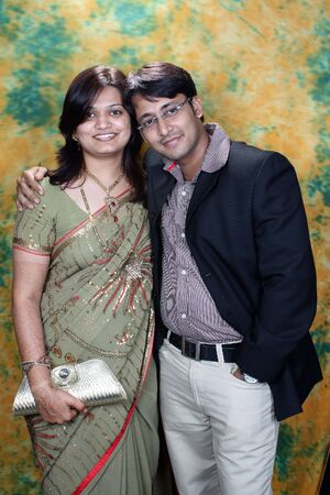 A portrait of a newly married Indian couple.