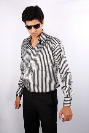 A stylish Indian teenager wearing sunglasses, on white studio background. photo