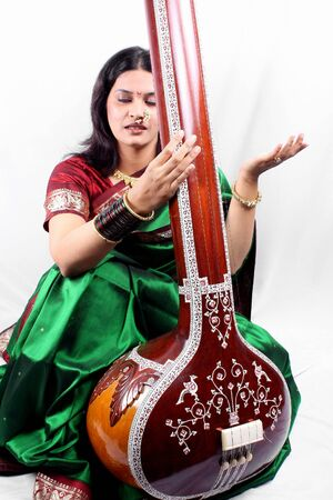 devotional: An Indian classical singer with the string instrument called Tanpura. Stock Photo