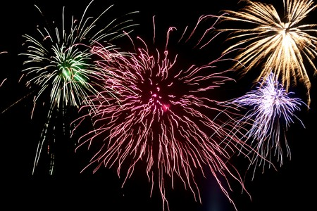 A background of bright colorful fireworks in the sky. Stock Photo - 7366062