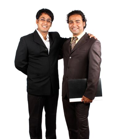 Two young Indian businessmen, on a white studio background. Stock Photo