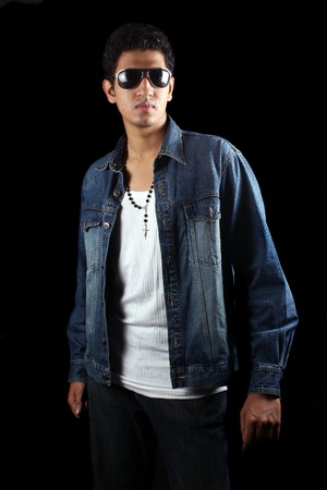 homem: A handsome young Indian guy, on black studio background.