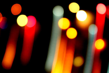 A background of trailing optic fibre lights in different colors. Stock Photo - 8187215