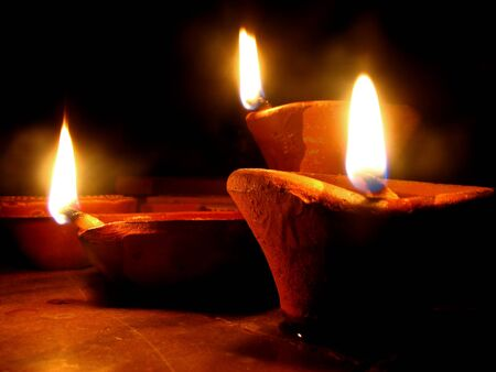 diwali: Beautiful clayearthen lamps traditionaly lit on the occassion of Diwali festival in India. Stock Photo