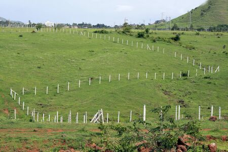 plots: Fencing laid to mark empty plots on a landscape. Stock Photo