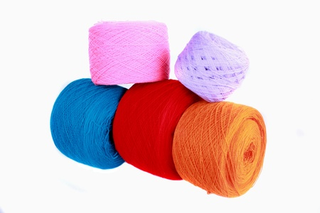 spindles: Spindles of wool in bright colors, isolated on white background.