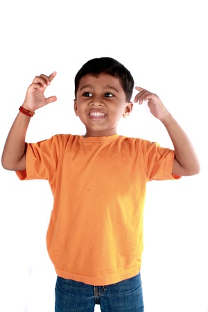 A happy Indian kid, isolated on white background.