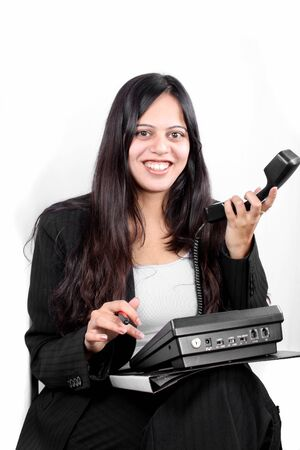 A smiling Indian businesswoman showing a phone without network connection or connecting cables to it. Stock Photo - 8904737