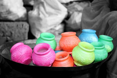 Colorful clay pots for the traditional festival of colors - Holi. Stock Photo
