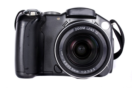 A digital camera with 12x zoom lens, isolated on white background. Stock Photo