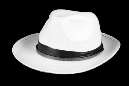 fedora hat: A white fedora hat, isolated on black studio background.
