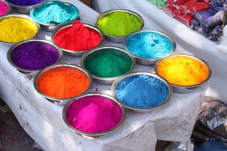 Colored powder traditionally for sale on the occassion of holi festival in India. Stock Photo