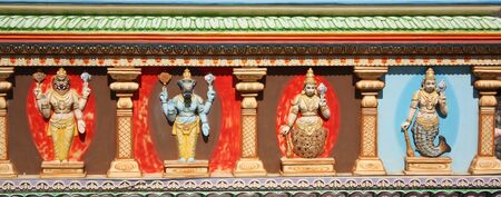vishnu: Colorful sculptures depicting avatars of hindu god Vishnu on a temple wall in India. Stock Photo