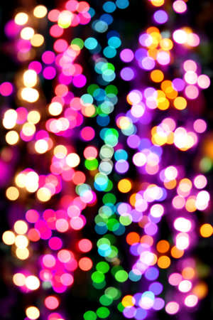 A background of colorful light blurs.