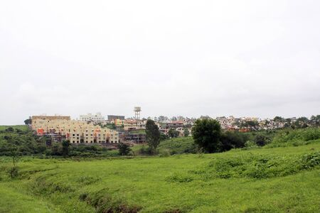 encroach: Increasing city population threatening to encroach upon the green pastures in the countryside.