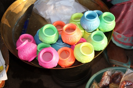 Colorful pots with religious designs for sale on the occassion of Diwali festival in India. Stock Photo - 9898916