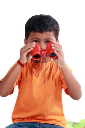 A small indian boy with a pair of binoculars. photo