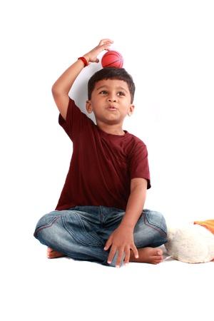 A cute Indian boy in a playful mood.