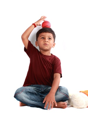 A cute Indian boy in a playful mood. photo