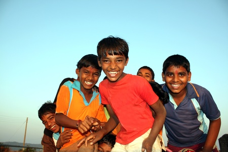 Poor kids from India in a happy mood. Stock Photo