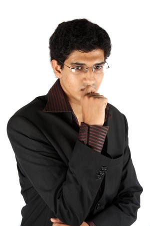 A young Indian businessman in a worried mood, on white studio background. photo