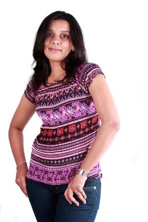 A beautiful Indian teenage girl, on white studio background. Stock Photo