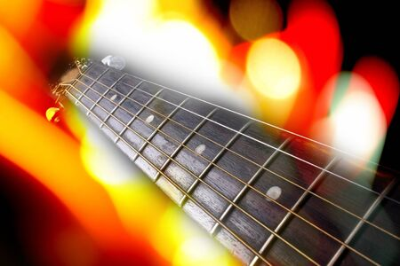 fretboard: A musical background of a guitar fretboard in colorful lights.