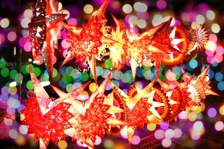 Beautiful lit traditional skylanterns on the backdrop of colorful lights, on the occassion of Diwali festival in India.