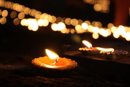 Traditional Diwali lamps and candles lit on the occassion of Diwali festival in India. photo