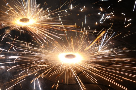 fire crackers: A type of fireworkcracker rotating on the ground, during the Diwali festival celebrations in India.