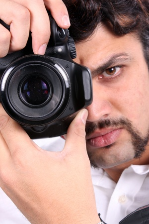 A closeup video of an Indian photographer with focus on the camera. Stock Photo - 11793994