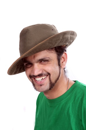 A portrait of a handsome young Indian man wearing a hat, on white studio background. Stock Photo - 11793991