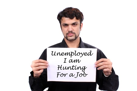 An unemployed Indian man holding a Looking for Job banner, on white studio background.