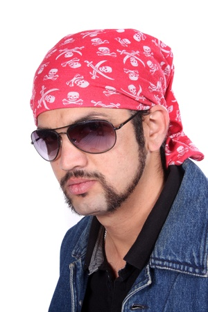 headgear: A portrait of a stylish handsome Indian guy wearing a pirates headgear, on white studio background.