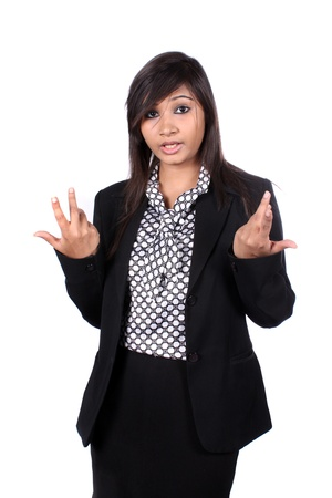 A young beautiful Indian female executive asking a question, on white studio background. photo