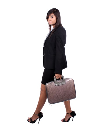 A young Indian businesswoman going for work, on white studio background. photo