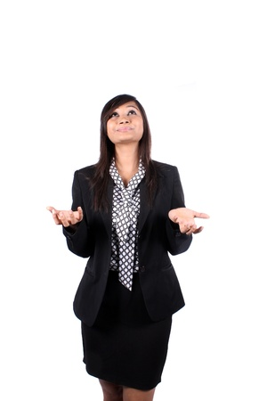 young executives: A frustrated Indian businesswoman asking god for help, on white studio background. Stock Photo