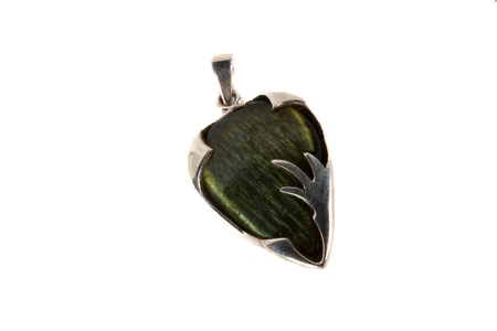 stimulate: A pendant of a green labradorite gemstone used in stimulate enthusiasm and imagination in crystal therap, isolated on white studio background. Stock Photo